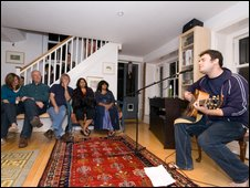 Ben Arthur performing in the living room