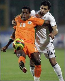 Abdul Kader Keita (l) in action for Ivory Coast