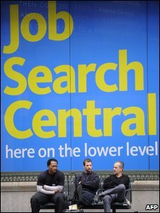 Men sitting by a poster advertising a job searching service