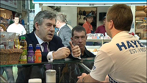 Prime Minister Gordon Brown talking to fishmonger Cliff Hocken
