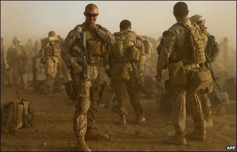 US Marines from 2nd Battalion, 8 Marine Regiment of 2nd Marine Expeditionary Brigade wait to board helicopters as they leave to take part in Operation Khanjar - Strike of the Sword - at Camp Dwyer in Helmand Province on July 2, 2009