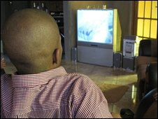 South African man watching TV, file image