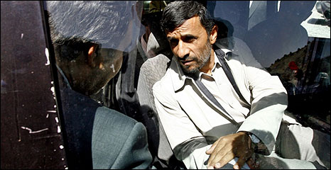 President Ahmadinejad talks to a construction worker in Tehran