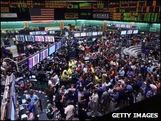 Traders work on the floor of the New York Mercantile Exchange