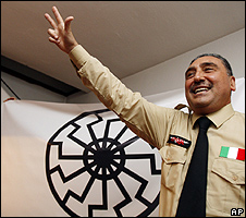 National Guard leader Gaetano Saya gives his group's salute, 1 Jul 09