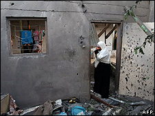 Palestinian woman in damaged house in Gaza