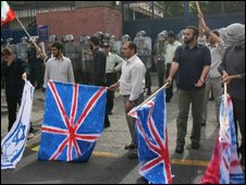 Iranian hardline students protest with US, British and Israeli flags outside the UK embassy in Tehran on 23 June 2009