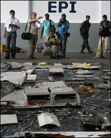 Journalists report the first wreckage pieces and objects of the Air France A330 aircraft, flight AF447, lost in midflight over the Atlantic ocean Jene 1st and recovered from the sea, at the airbase hangar, in Recife, northeastern Brazil, on June 12, 2009