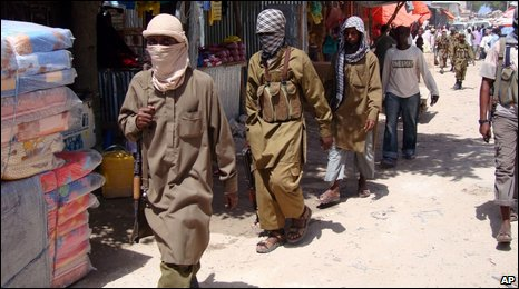 Armed Al-Shabab fighters patrol Bakara Market in Mogadishu, Somalia, on 29 June 2009