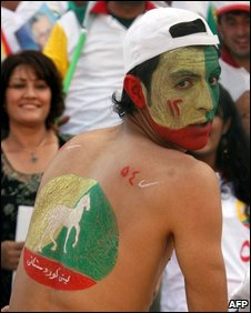 An Iraqi Kurdish supporter painted in the colours of the Kurdistan Democratic Party