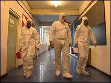 Asbestos testers visit a school