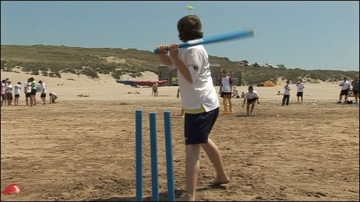 Beach cricketer in action