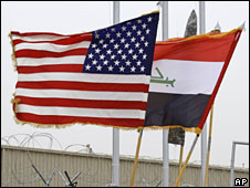 The US and Iraqi flags fly at a handover ceremony in Baghdad, 10 February, 2009
