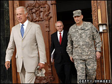 Joe Biden (L), US Ambassador to Iraq Christopher Hill and Gen Ray Odierno emerge after a meeting in Baghdad, 7 July 2009