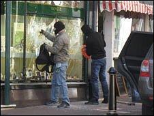Two men raiding the Benzie yachting jewellery shop