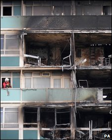 Fire officials inspect the burnt out flats in Camberwell
