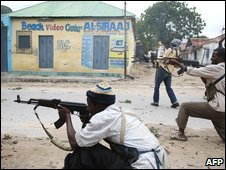 Hard-line islamist fighters exchange gun fire with government forces in Mogadishu on July 3, 2009