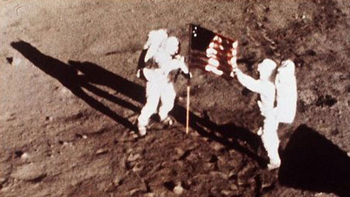 Neil Armstrong and Buzz Aldrin plant the US flag on the moon