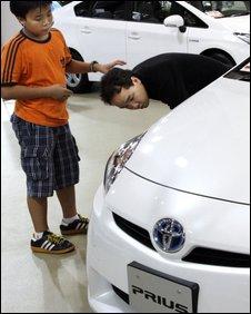 People look at a Prius