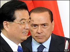 Italian Prime Minister Silvio Berlusconi (R) and Chinese President Hu Jintao arrive for the G8 meeting