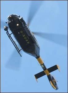 the South Wales Police helicopter passes over Anthony James' house in Gowerton.