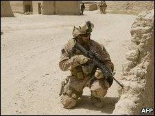 """US Marine takes position during a patrol with Afghan National Police in the district of Garmsir in Afghanistan""""s Helmand Province on July 5, 2009."""