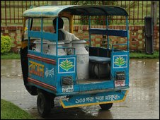 Milk being delivered in churns to the factory in Bogra