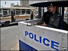 his photo taken on June 11, 2009 shows Pakistani police standing guard at a post located in a sensitive area of Karachi, dotted with luxury hotels and important government offices