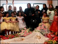 Iraqi schoolgirls visit the tomb of Saddam Hussein (2008 image)