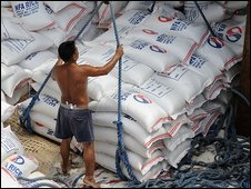 Sacks of rice being unloaded in Manila