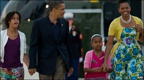 US President Barack Obama walks alongside wife Michelle Obama and daughters Sasha and Malia to Air Force One prior to leaving the US on Sunday 5 July on a week-long tour to Russia, Italy and Ghana.