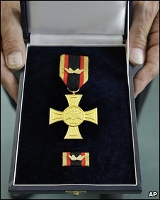 A German soldier shows off the Cross of Honour for Bravery