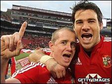 Shane Williams and Mike Phillips celebrate victory in the third Test