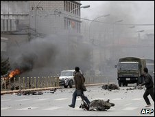 Tibetans throw stones at army vehicles on a street in the Tibetan capital Lhasa