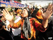"Muslim ethnic Uighurs cry during a protest in Urumqi in China""s far west Xinjiang region"