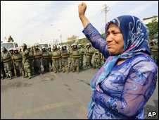 Uighur woman protesting, 07/07