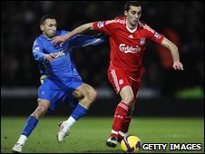 Alvaro Arbeloa of Liverpool (right) and Nadir Belhadj of Portsmouth
