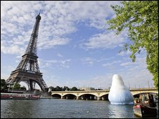 An inflatable iceberg floats in the River Seine in front of the Eiffel Tower