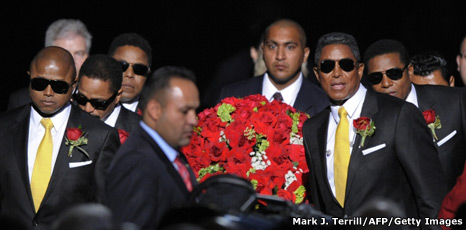 Jackson brothers carrying their brother's coffin