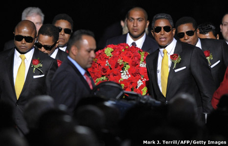 Jackson brothers carry their brother's coffin into LA's Staples Center