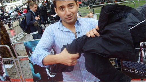 Ricky wrings the rain out of his jacket at the world premiere of Harry Potter and the Half-Blood Prince