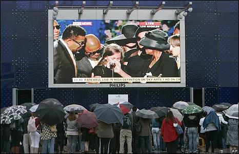 Memorial watchers at London's O2 arena