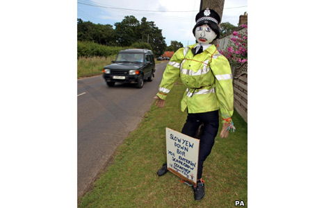 Scarecrow dressed as traffic officer in Brancaster, Norfolk