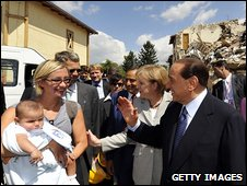 Italian Prime Minister Silvio Berlusconi meets residents of quake-damaged Onna, Italy