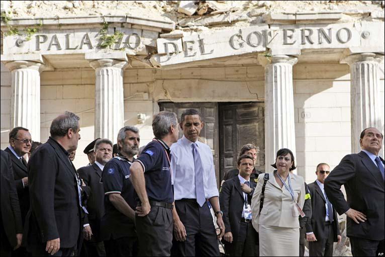 US President Barack Obama (centre) and Italian PM Silvio Berlusconi (far right) tour ruins of city