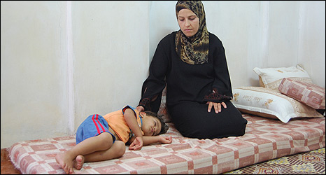 Sunna Abbas with her sick son, Mohammad, Faqua village, West Bank