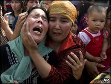 Uighur women grieve for their men who they claim were taken away by Chinese authorities