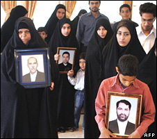 Families of some of the five Iranian diplomats carry portraits of their loved ones in Tehran on 18 May 2007