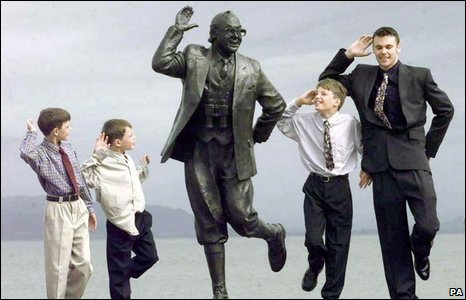 The grandchildren of comedian Eric Morecambe pose with the statue at the unveiling in 1999