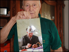 Silvio Sarra holds up a picture of his father